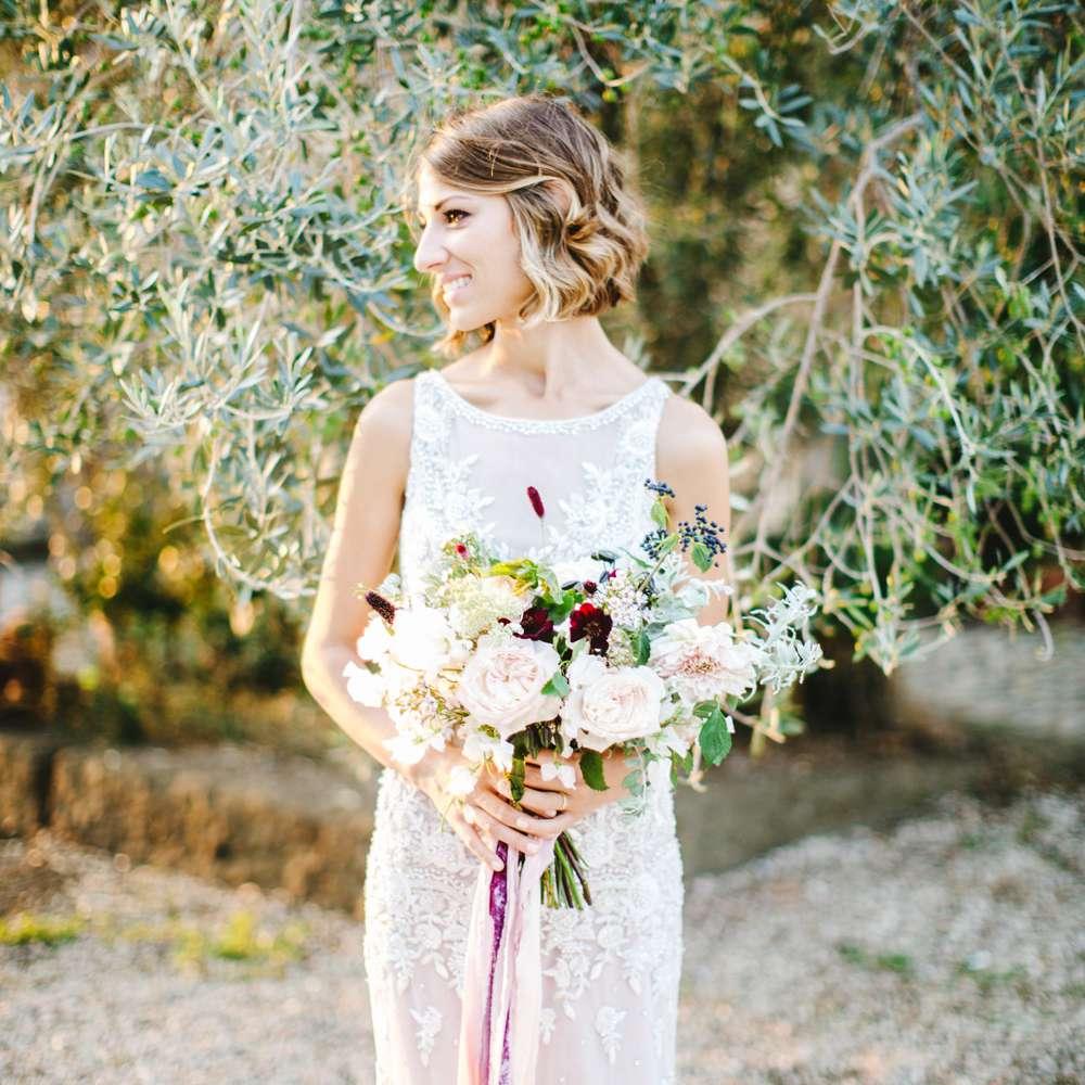 Bride solo holding bouquet