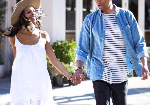 Janelle Marie Lloyd holding hands with partner