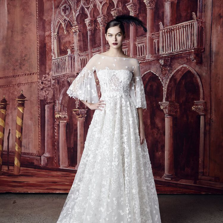 Model in illusion neckline wedding gown with floral lace detailing