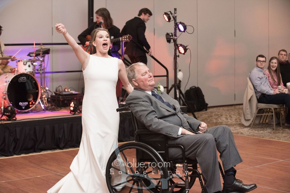 Bride dancing with father in wheelchair