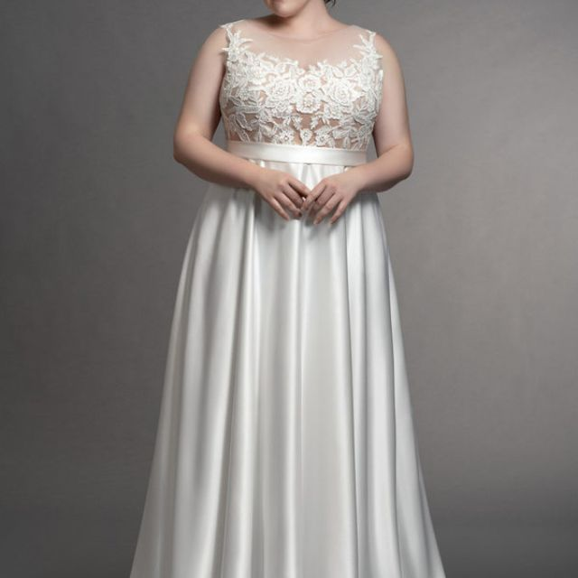 Plus size model in gown with floral bodice and silk skirt