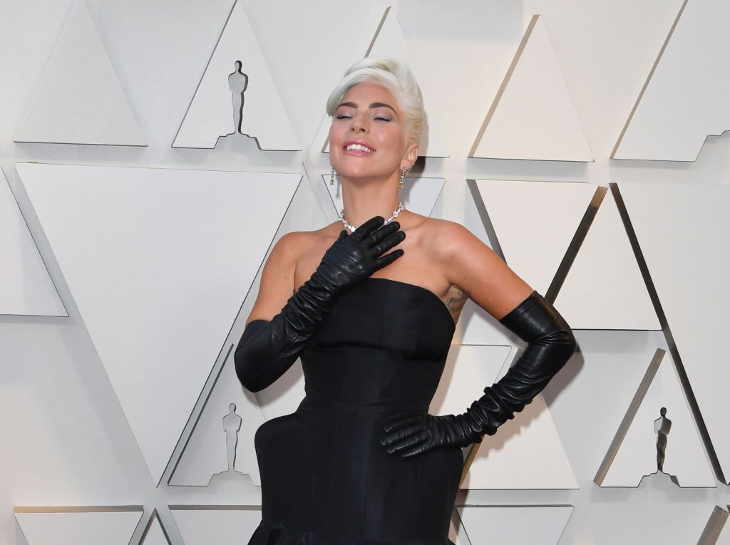 Lady Gaga in black dress and gloves at 2019 Oscars