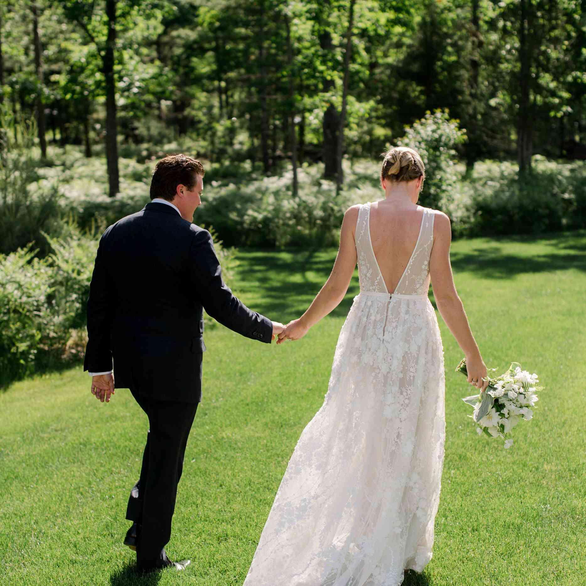 Newlyweds walking in yard
