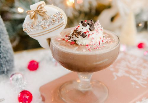 Hot cocoa cocktail with sugar cookie garnish
