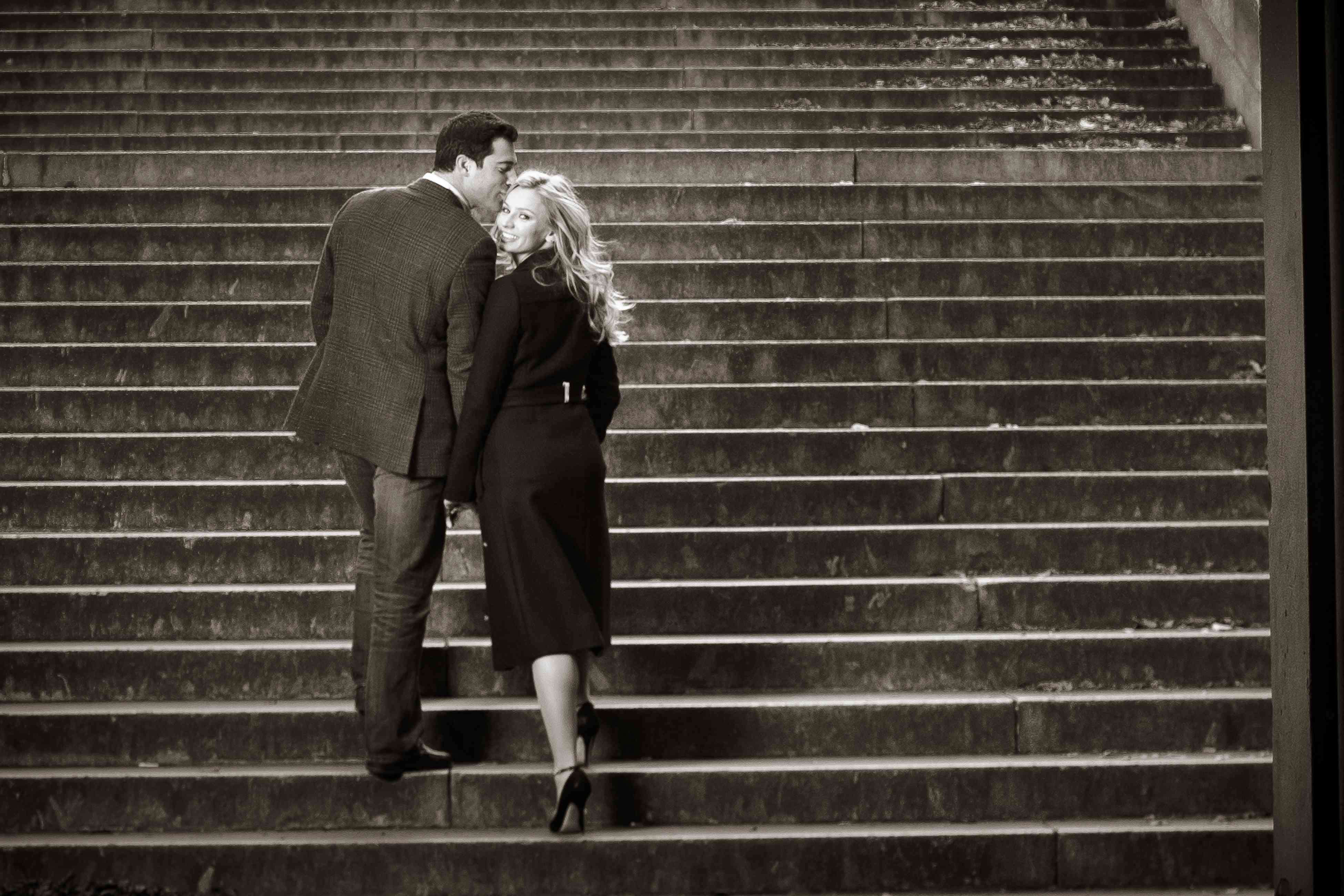 Couple walking up steps