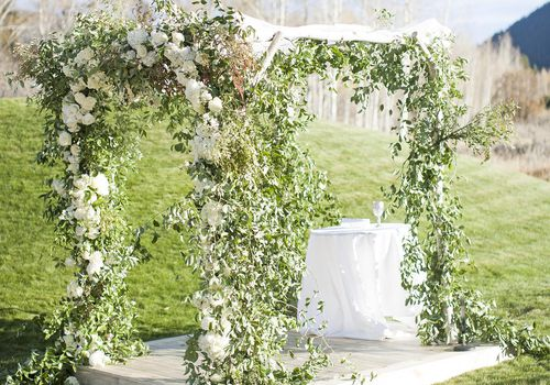A Chuppah with flowers and vines