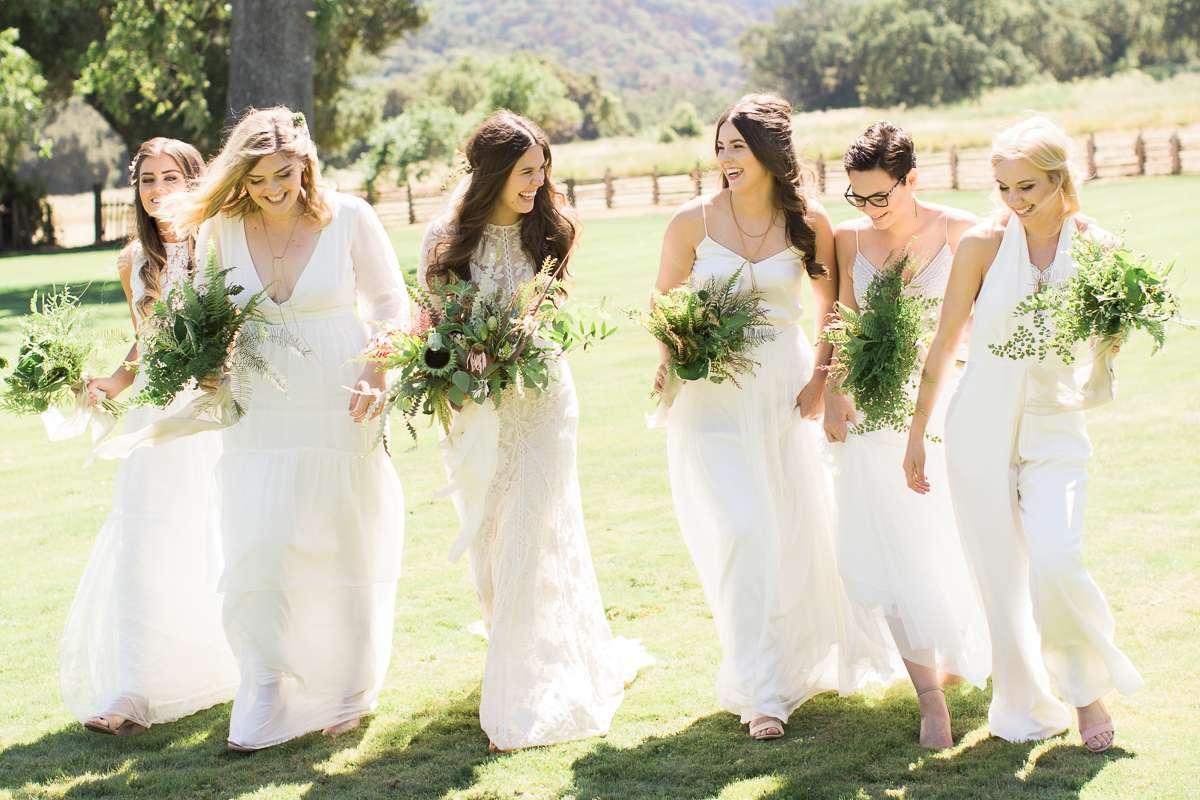 <p>Bride with bridesmaids in field</p><br><br>