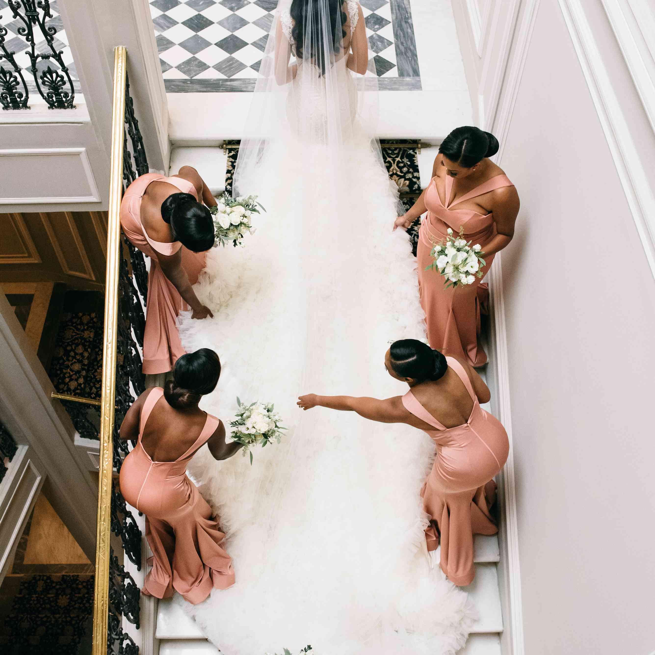 bridal party fixing wedding dress