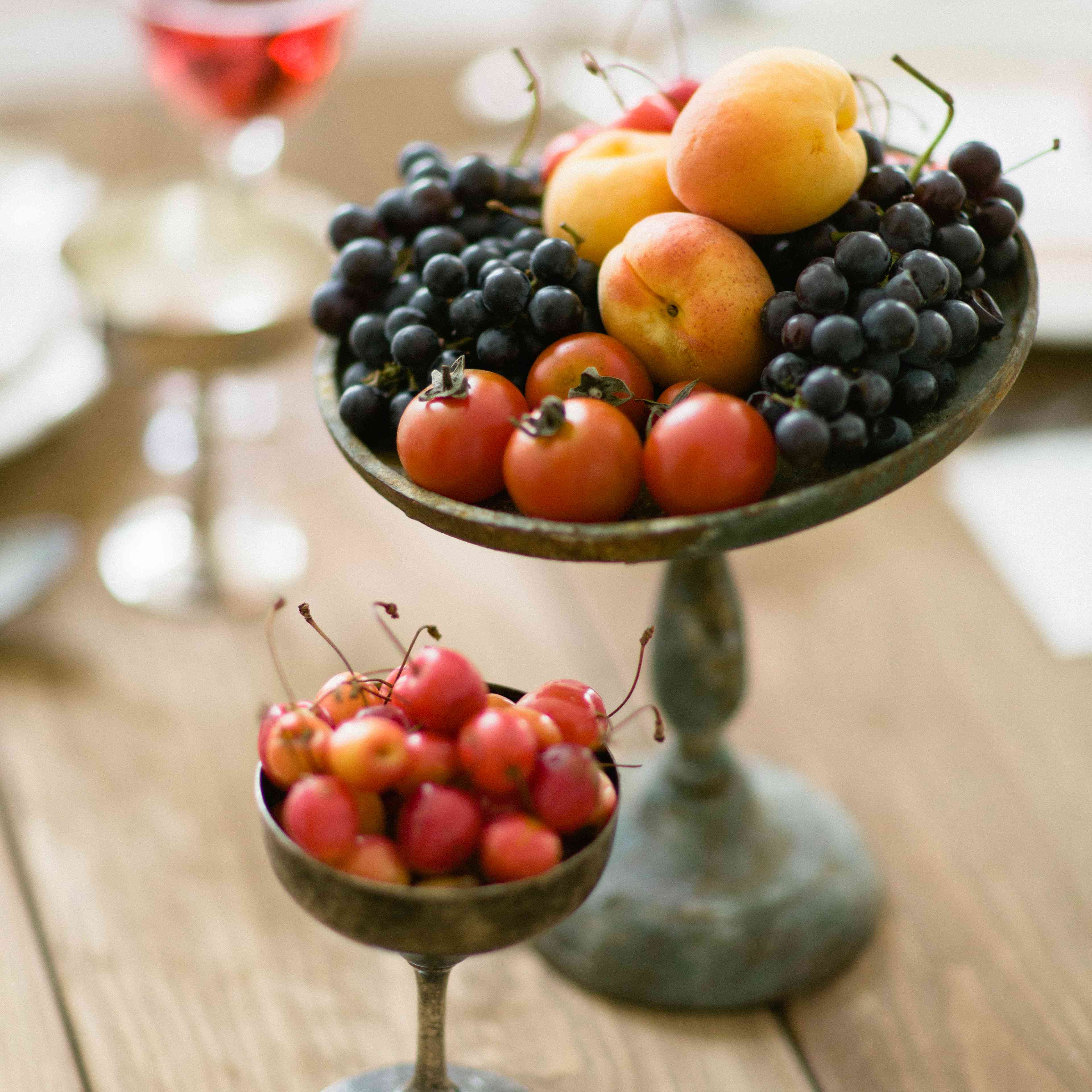 Cherries, blackberries, and apples in a metal centerpiece