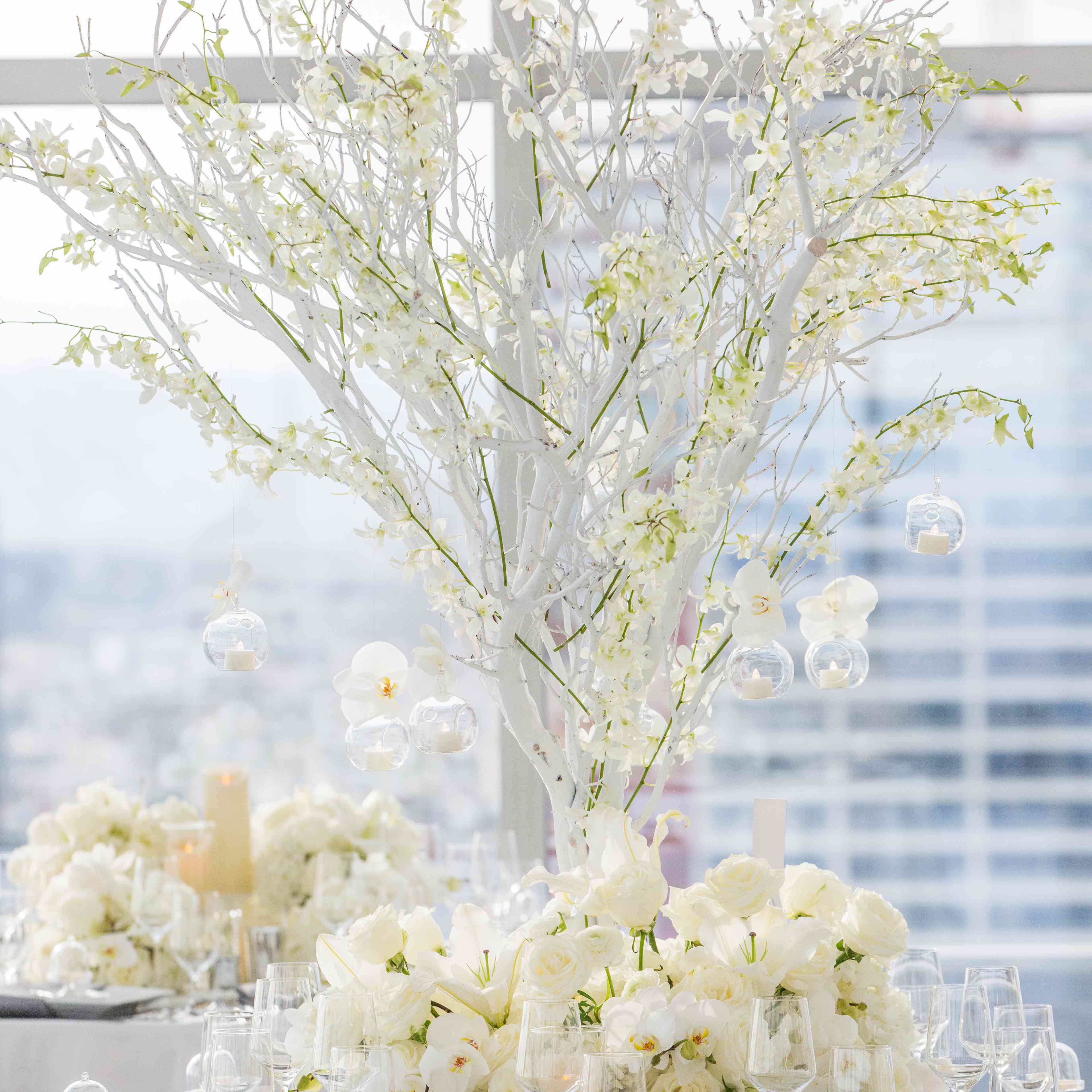 Manzanita branch orchids votive candles and glass orb centerpieces