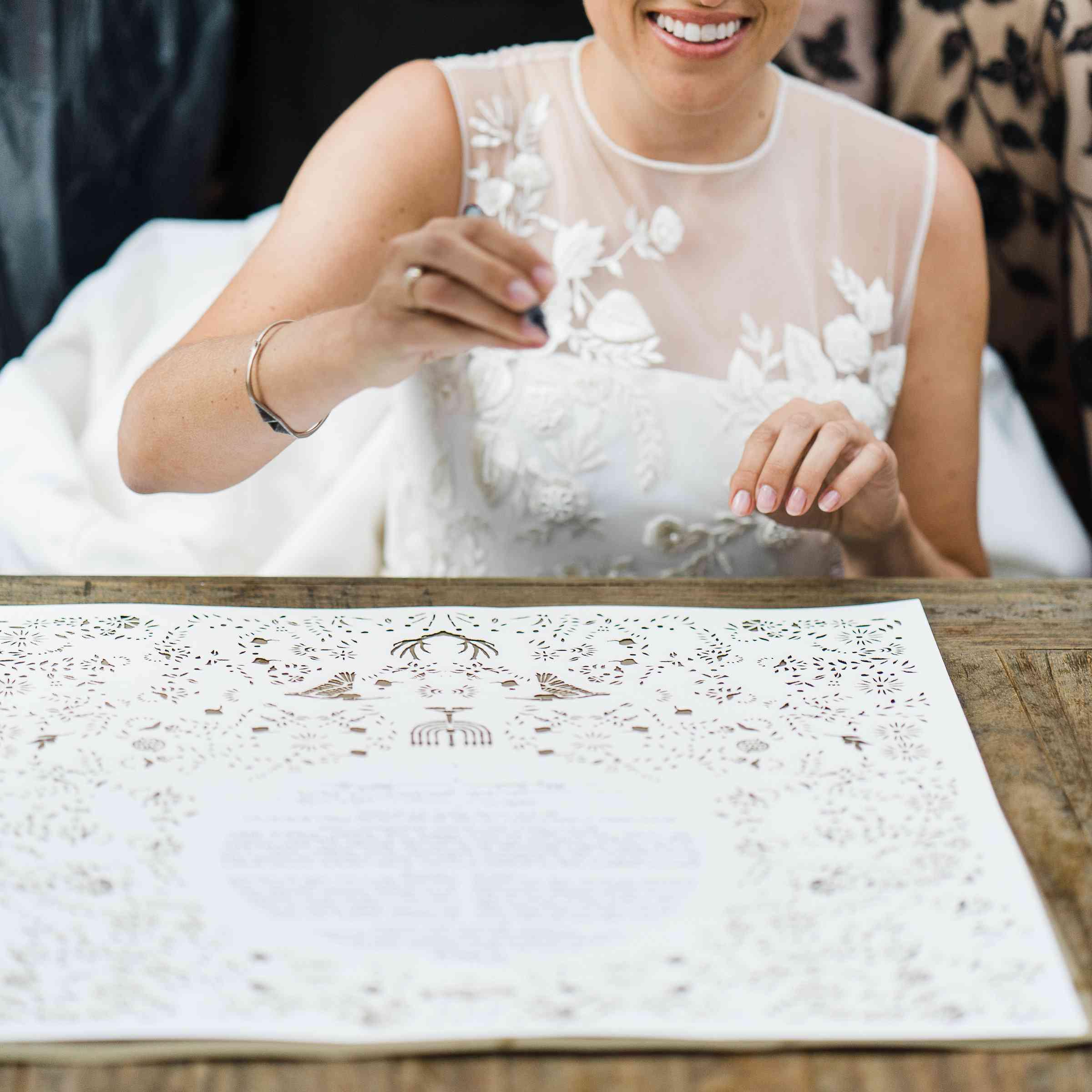 bride signing ketubah