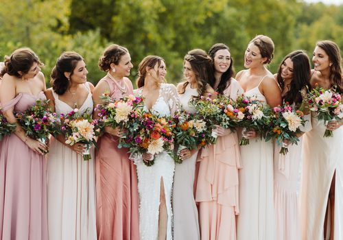 Bridesmaids all looking at each other with bride
