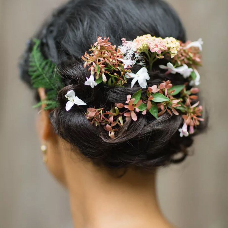 Flowers woven into an updo