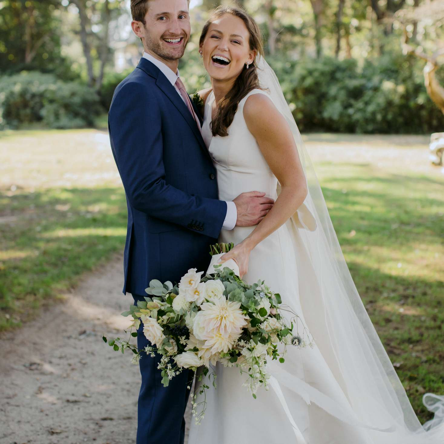 at-home rustic massachusetts wedding, bride and groom laughing