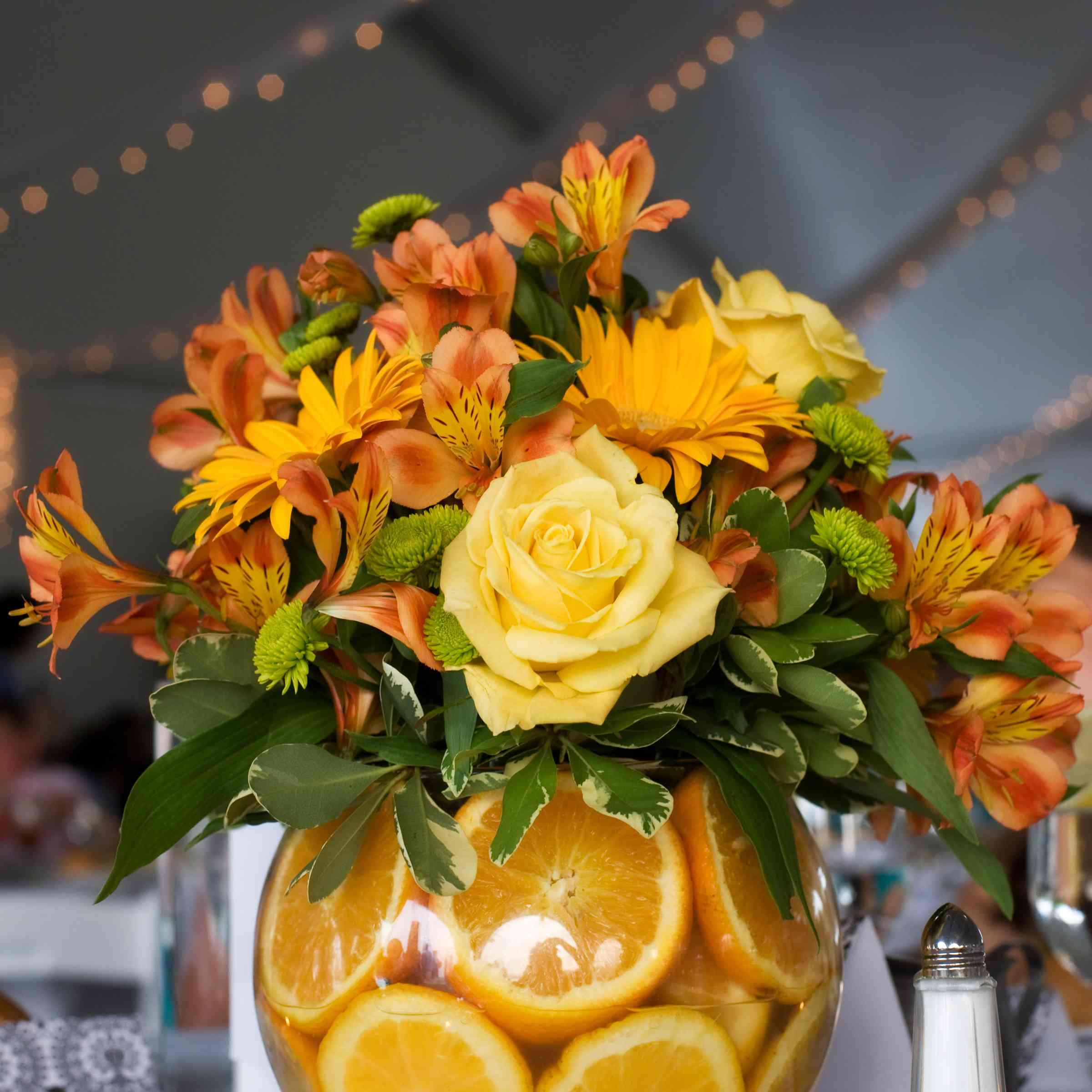 Orange slices with flowers as a centerpiece