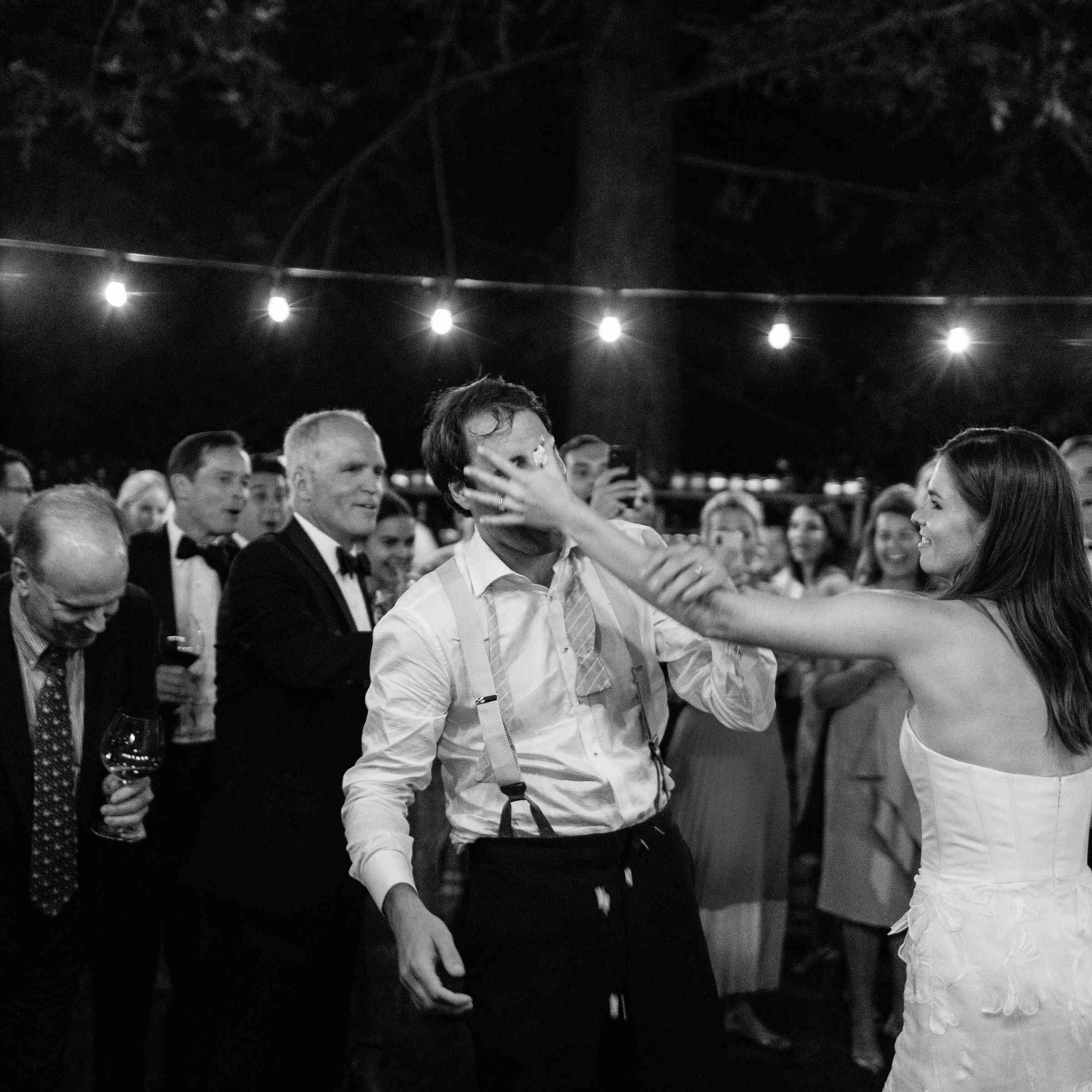 <p>bride throwing cake at groom</p><br><br>