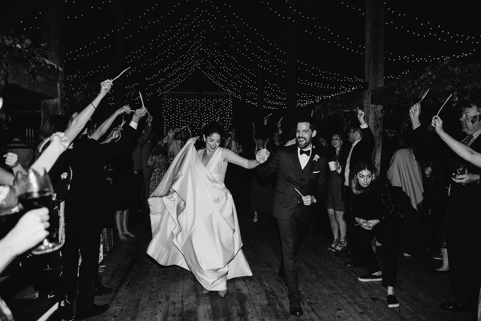 Bride and groom exiting reception