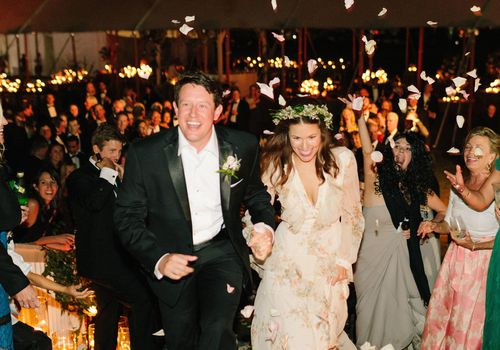 <p>bride and groom reception exit</p>