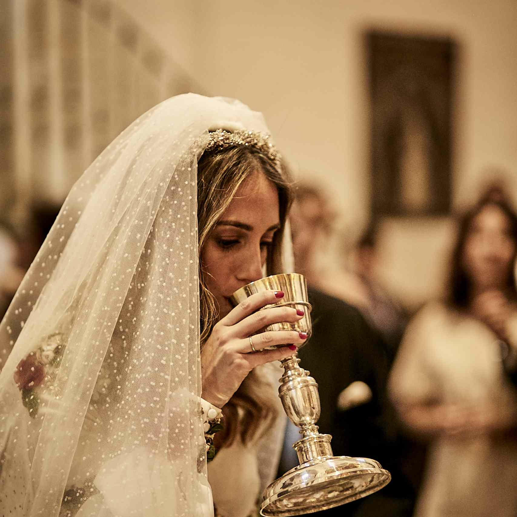 Bride taking communion