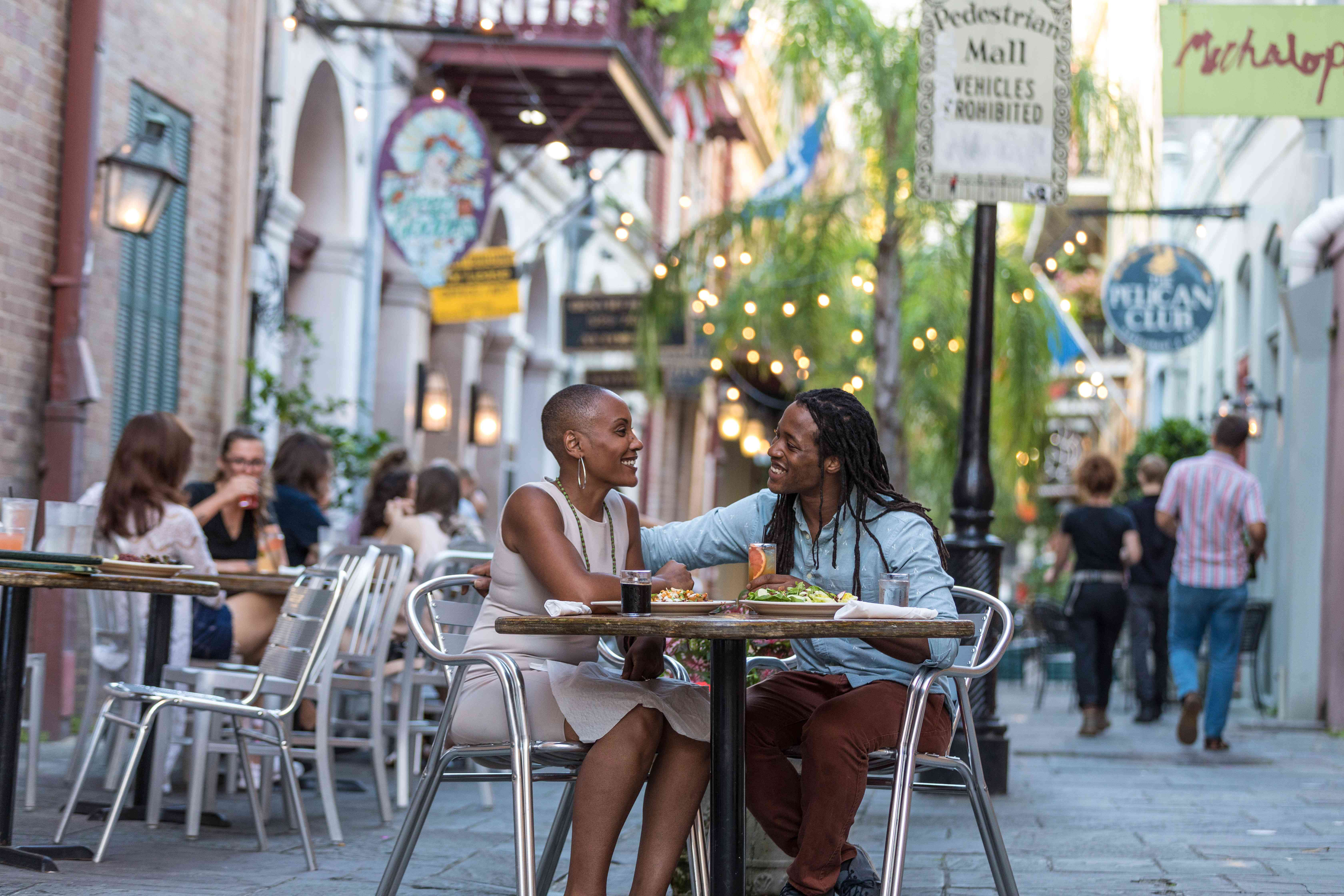 Couple outdoor dining in the courtyard in New Orleans
