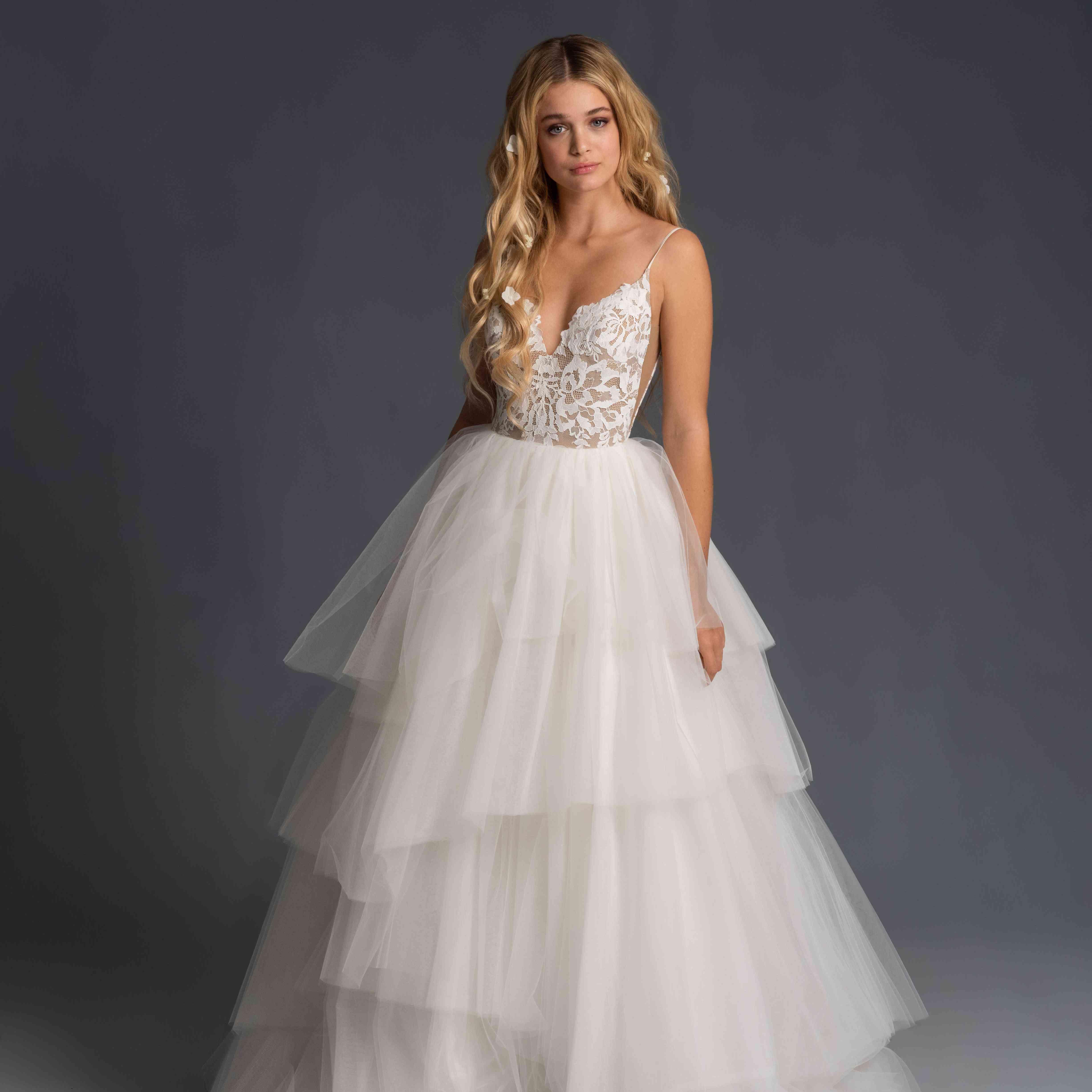Model in sleeveless tiered tulle wedding dress