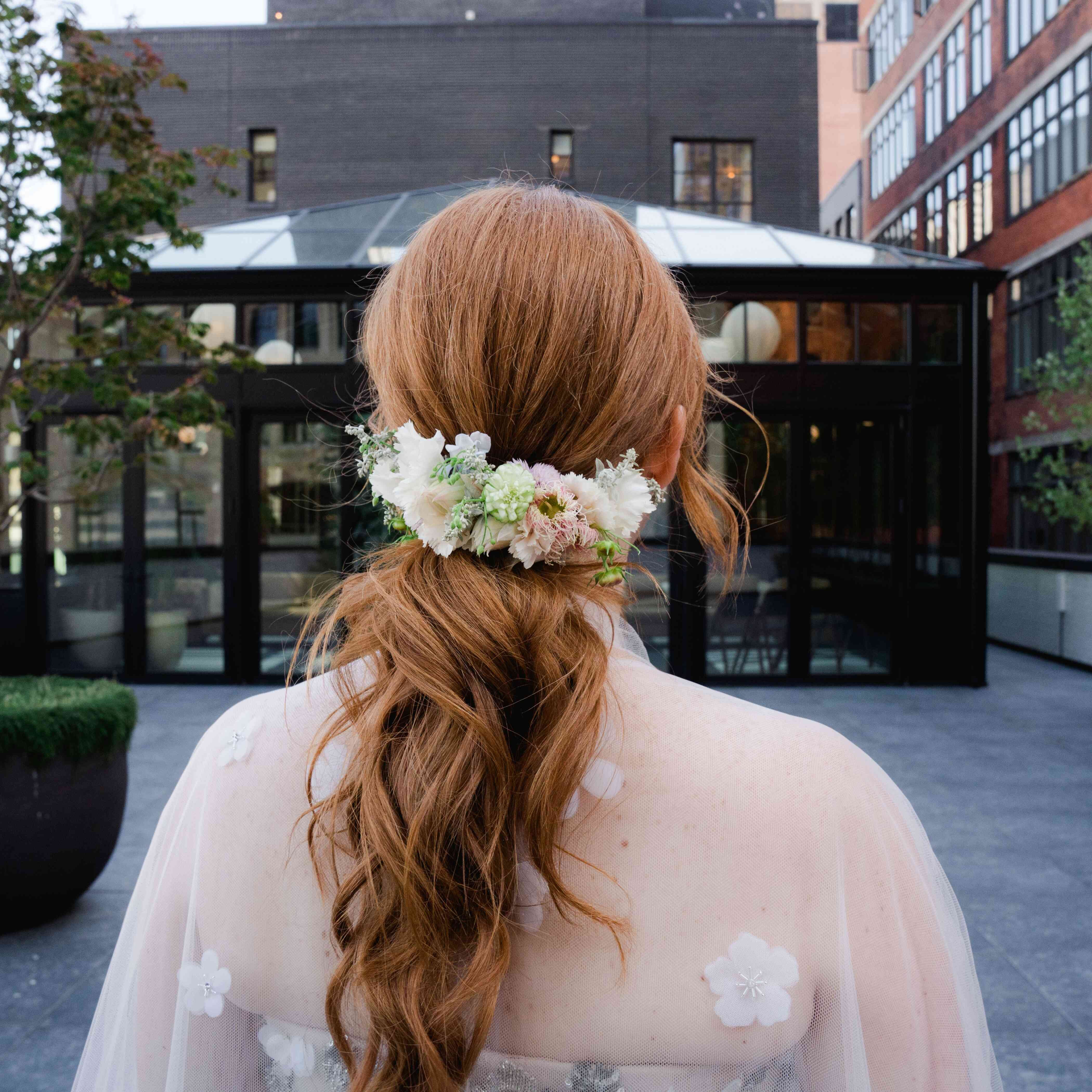 Floral-wrapped ponytail