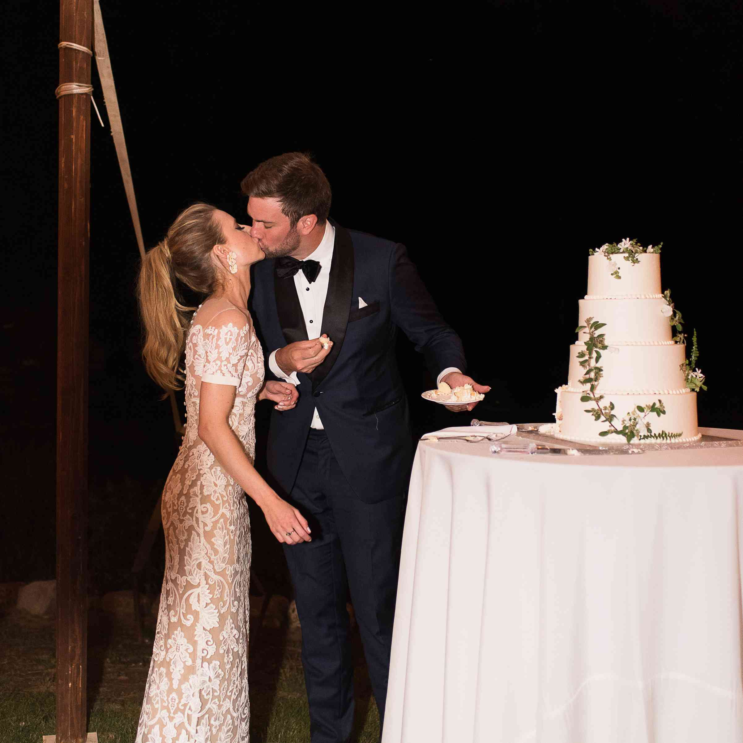 <p>Bride and groom cutting cake</p><br><br>