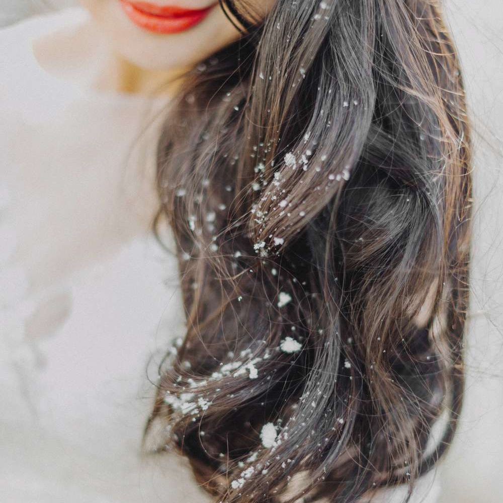 Close-up of bride's hair with snowflakes on it