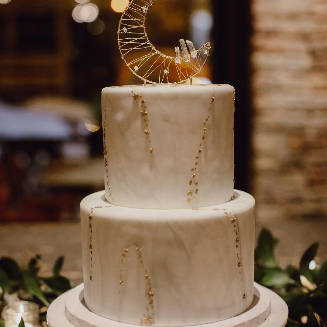 Wedding cake with a crescent moon topper