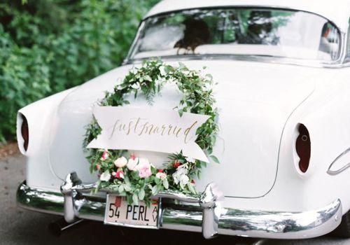 <p>Wedding Getaway Car with Wreath</p>