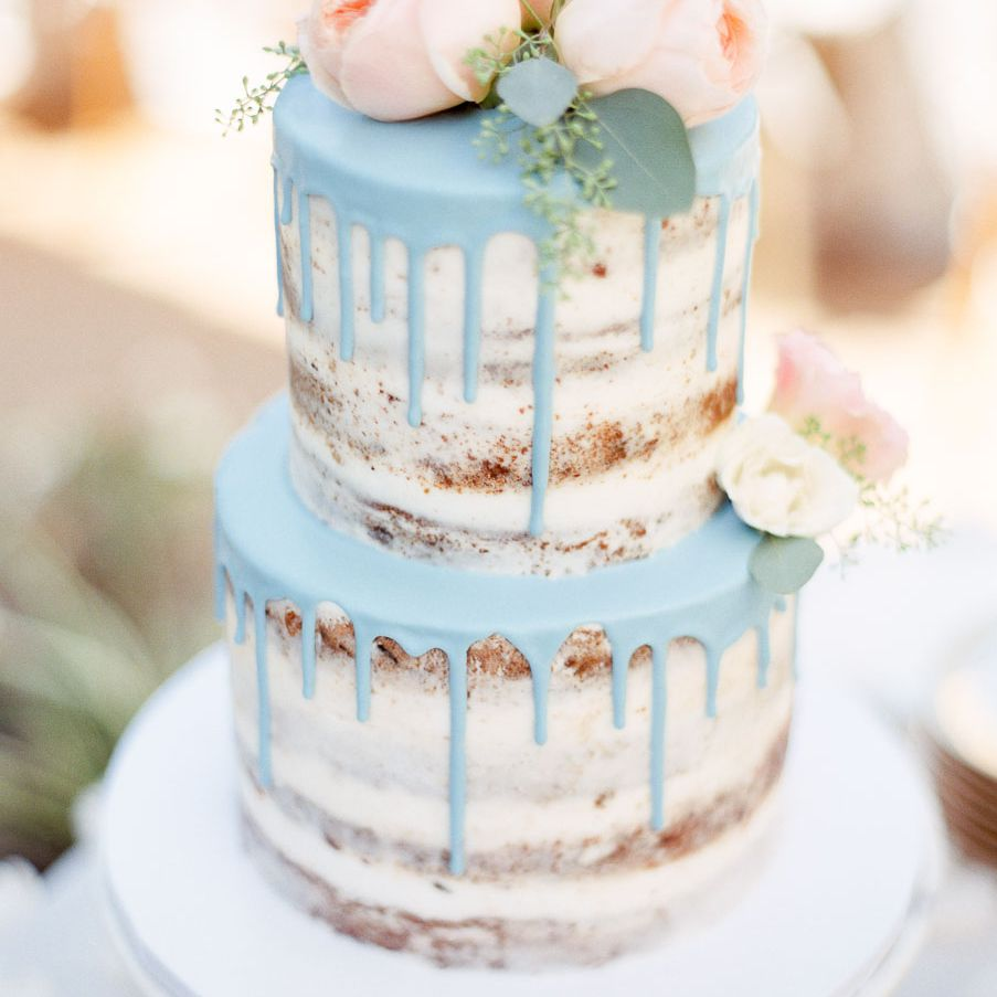 Blue drip cake with rose topper