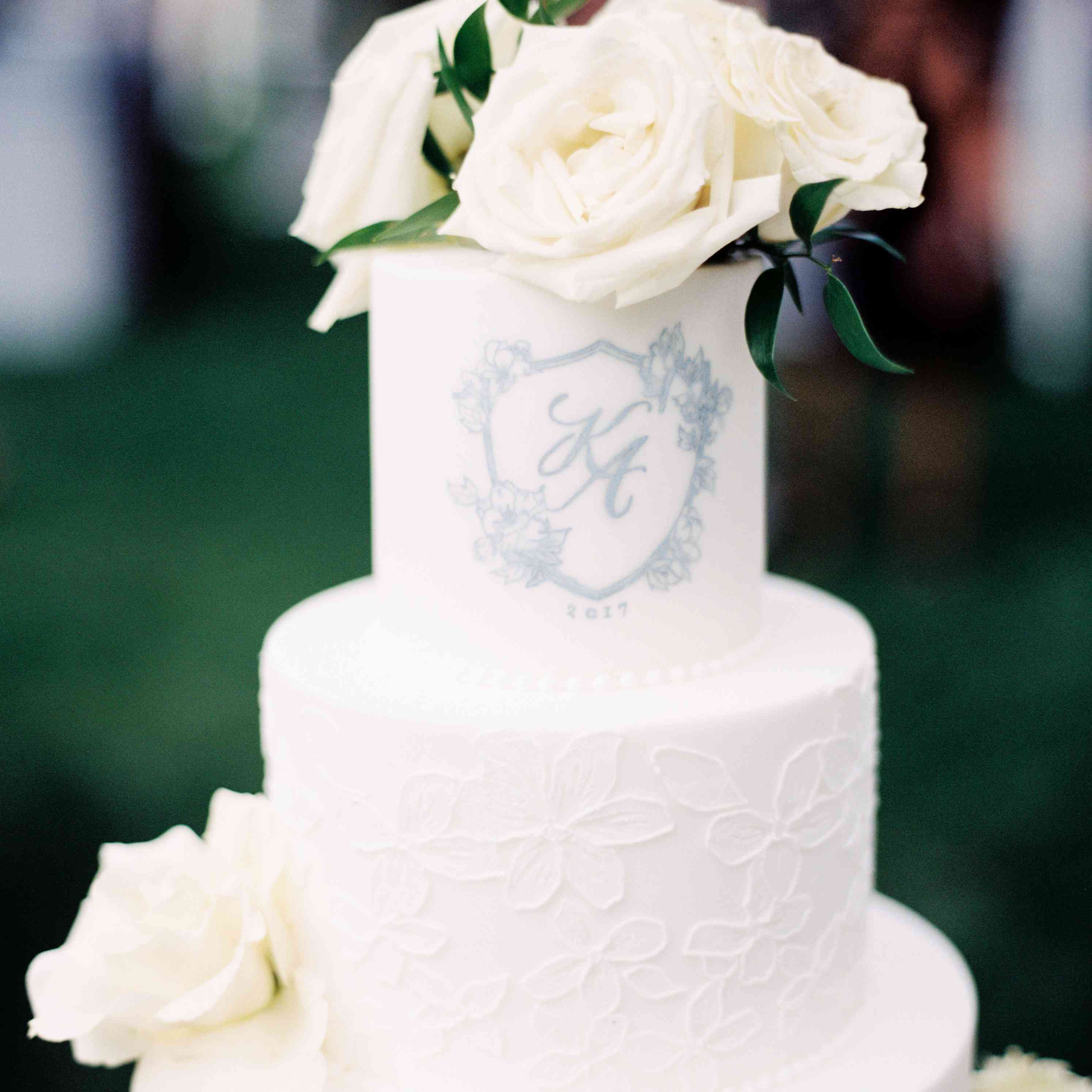 white cake with couple monogram