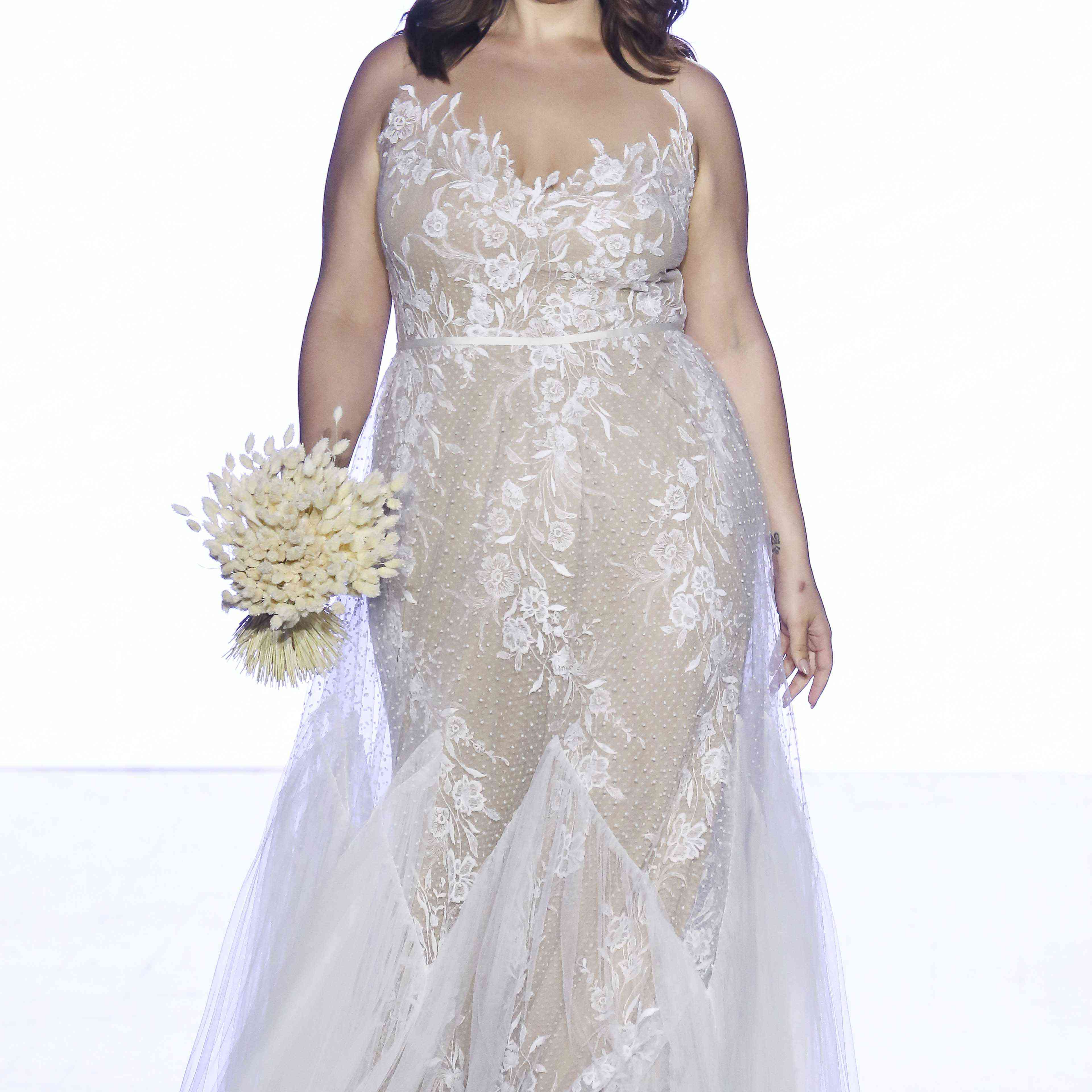 Model in lace and dotted tulle A-line gown
