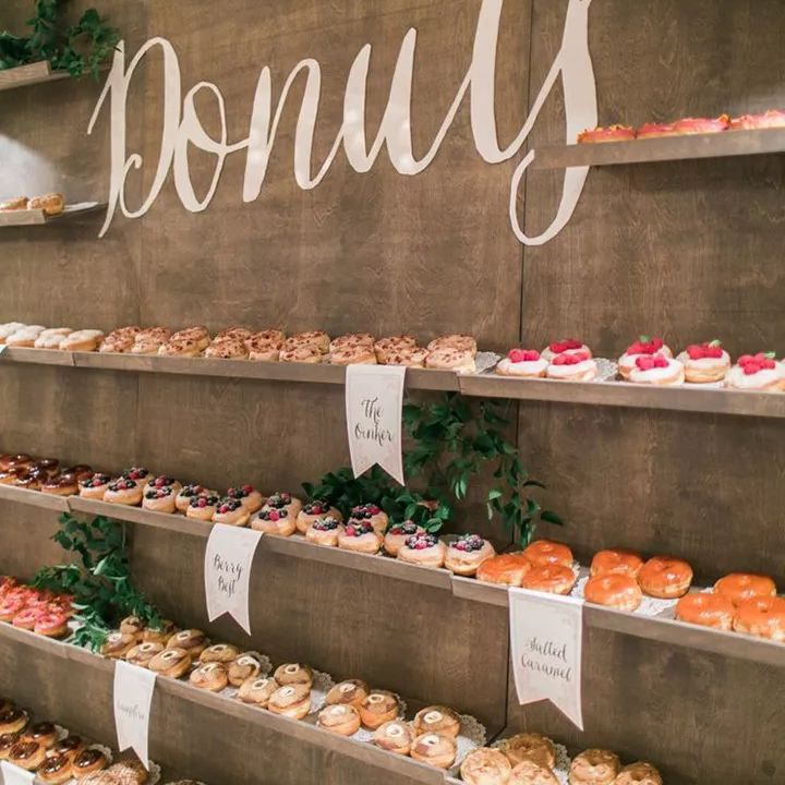 Shelves filled with donuts at wedding