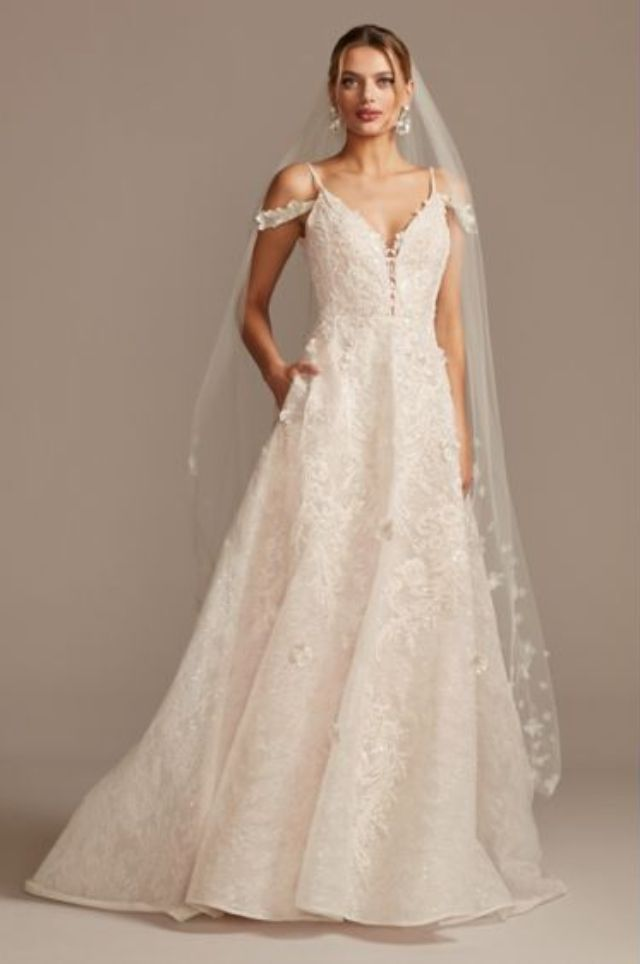 Model in wedding dress with pockets
