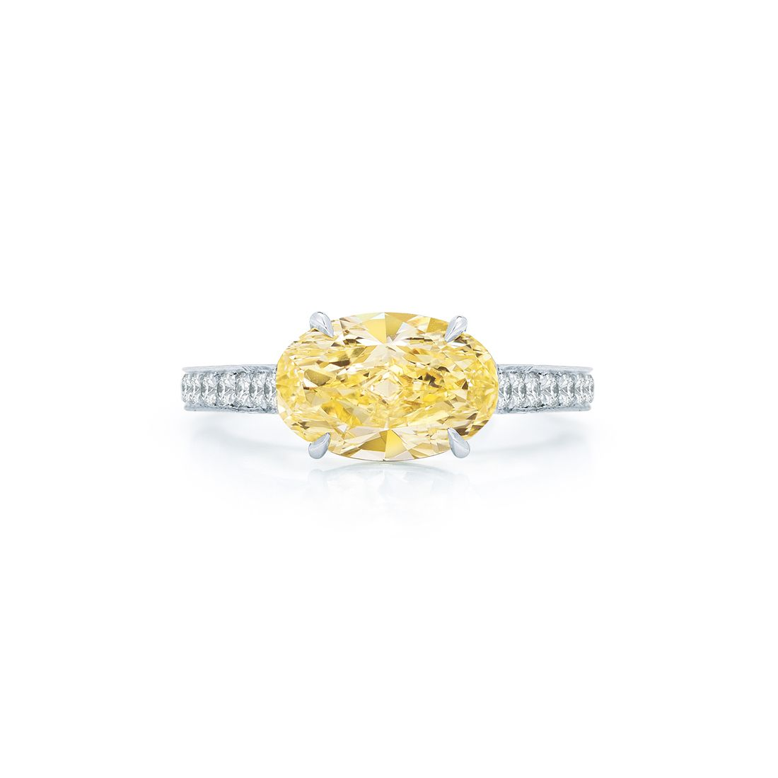 Oval yellow diamond ring with pave band