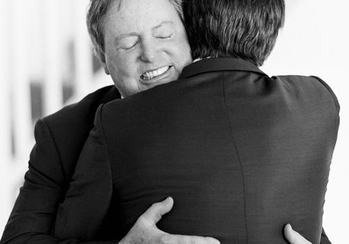 Father hugging future son-in-law