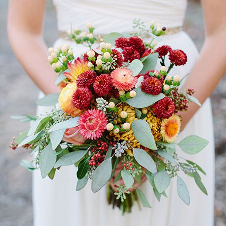 A mixed bouquet made of red and peach mums