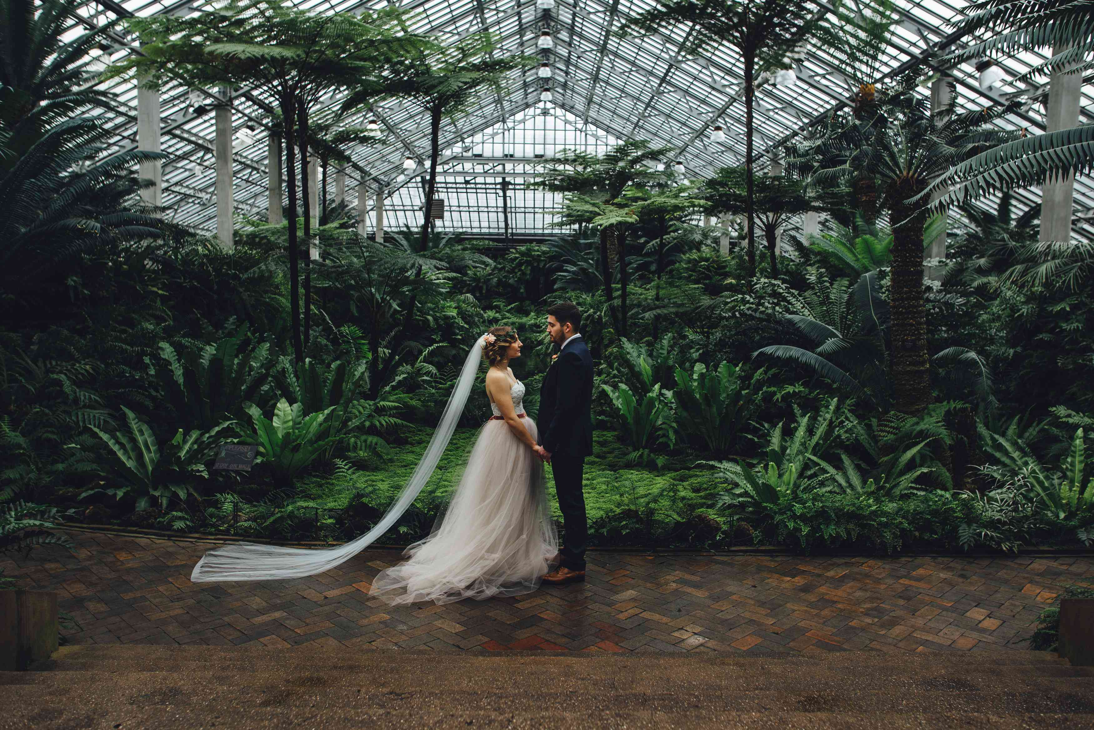 Couple posing in a greenhouse at Garfield Park Conservatory in Illinois