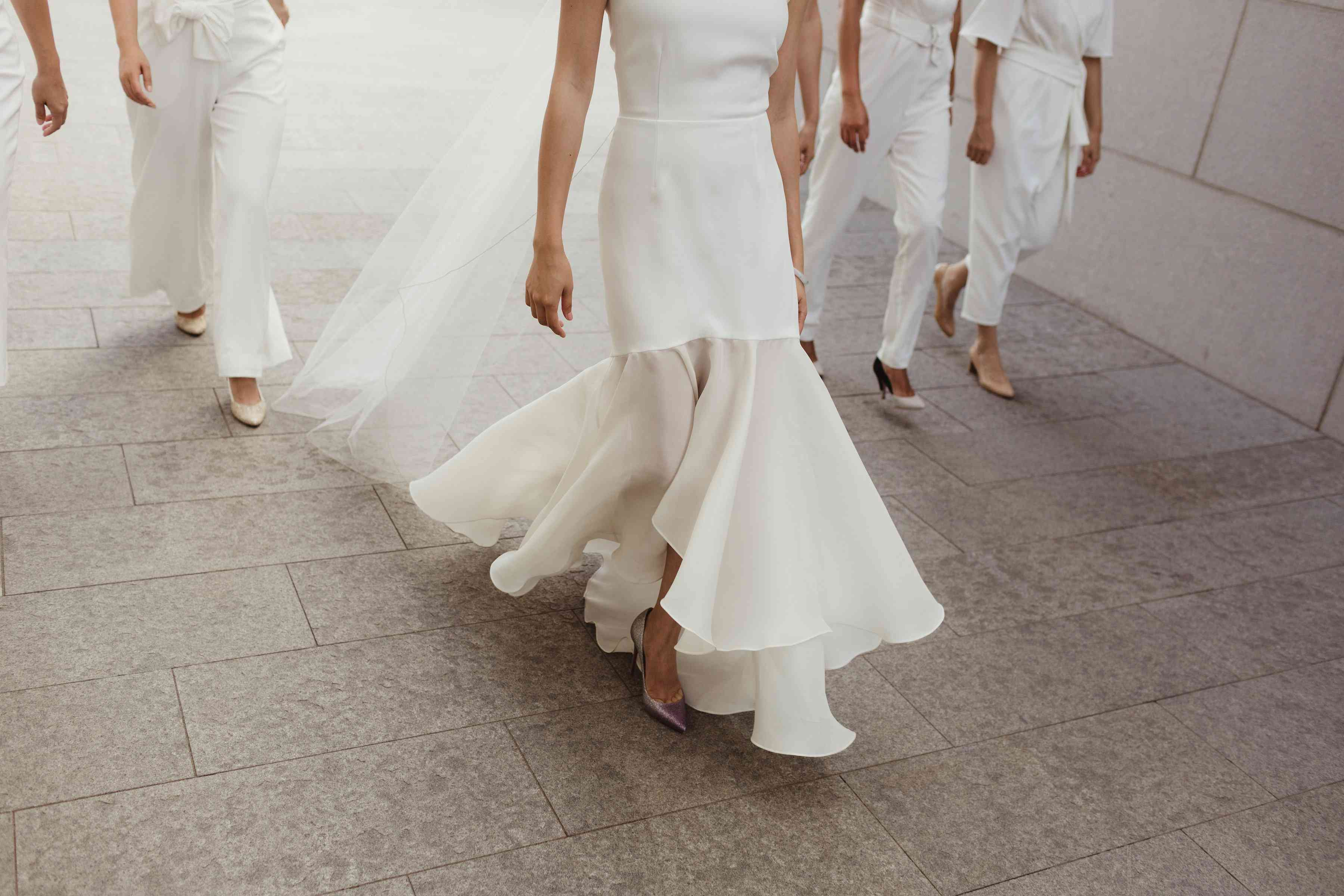Bride walking, shot of bottom half of gown