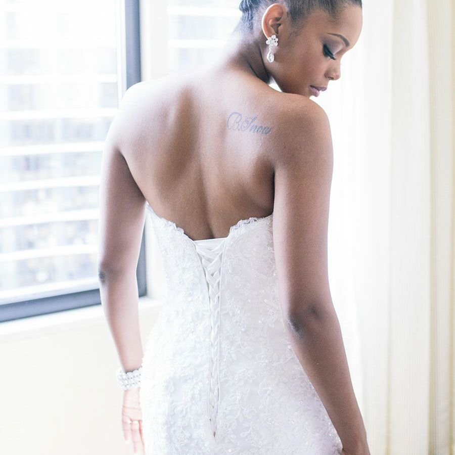 Bride with a tattoo on her shoulder blade