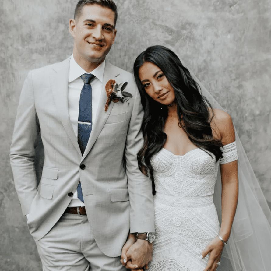 Newlyweds portrait holding hands