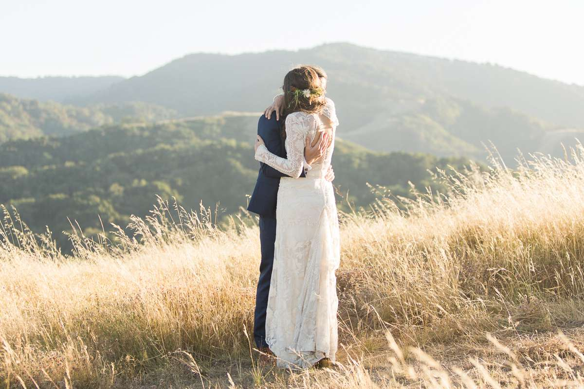 <p>Bride and groom hugging on mountain top</p><br><br>