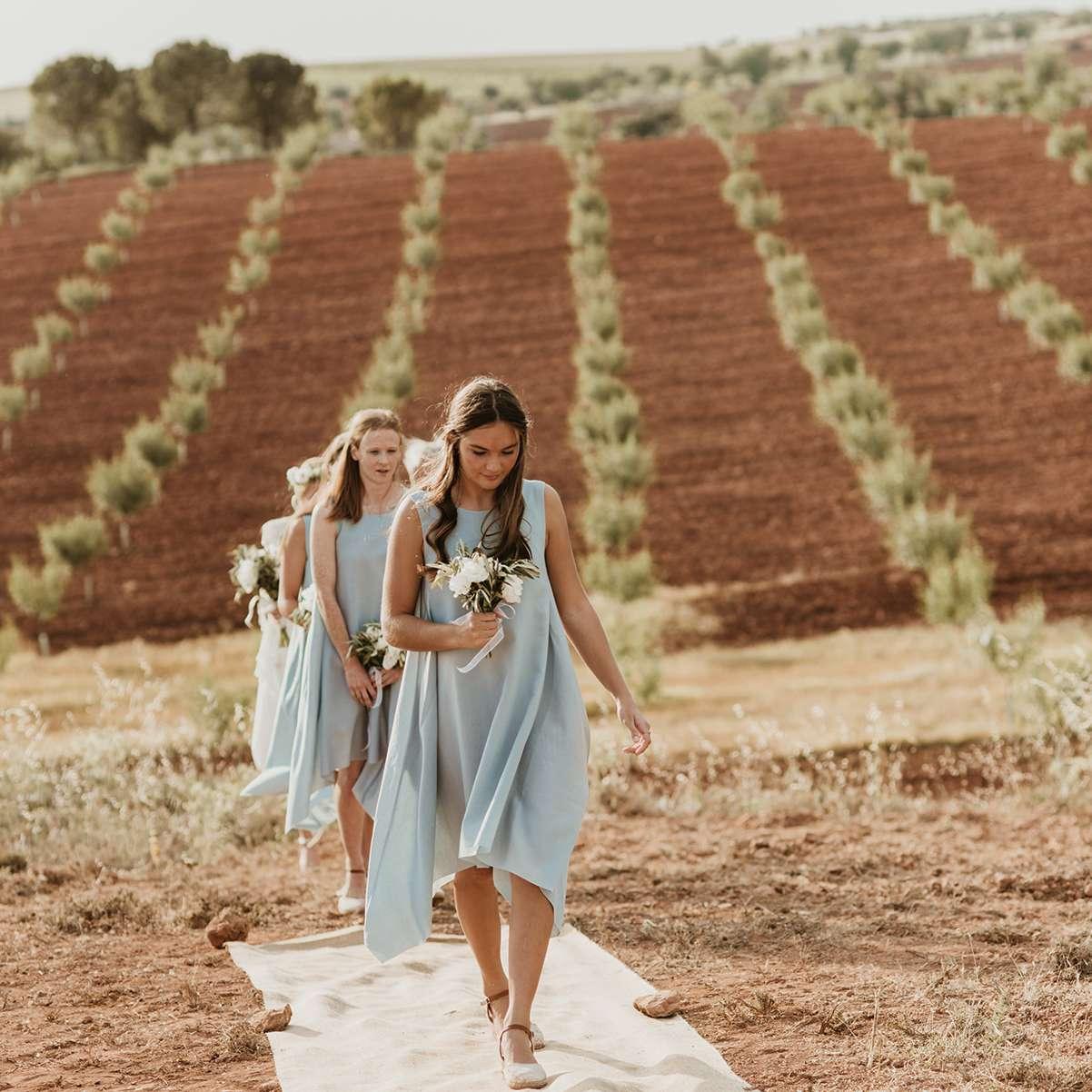 <p>Bridesmaids walking down the aisle</p><br><br>