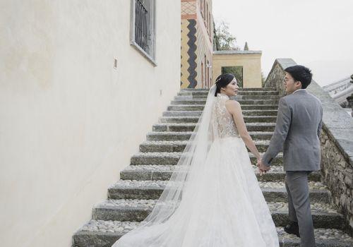 romantic lake como wedding, bride and groom holding hands