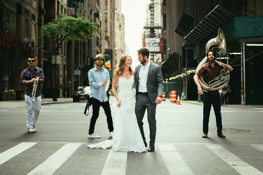 bride and couple with brass band