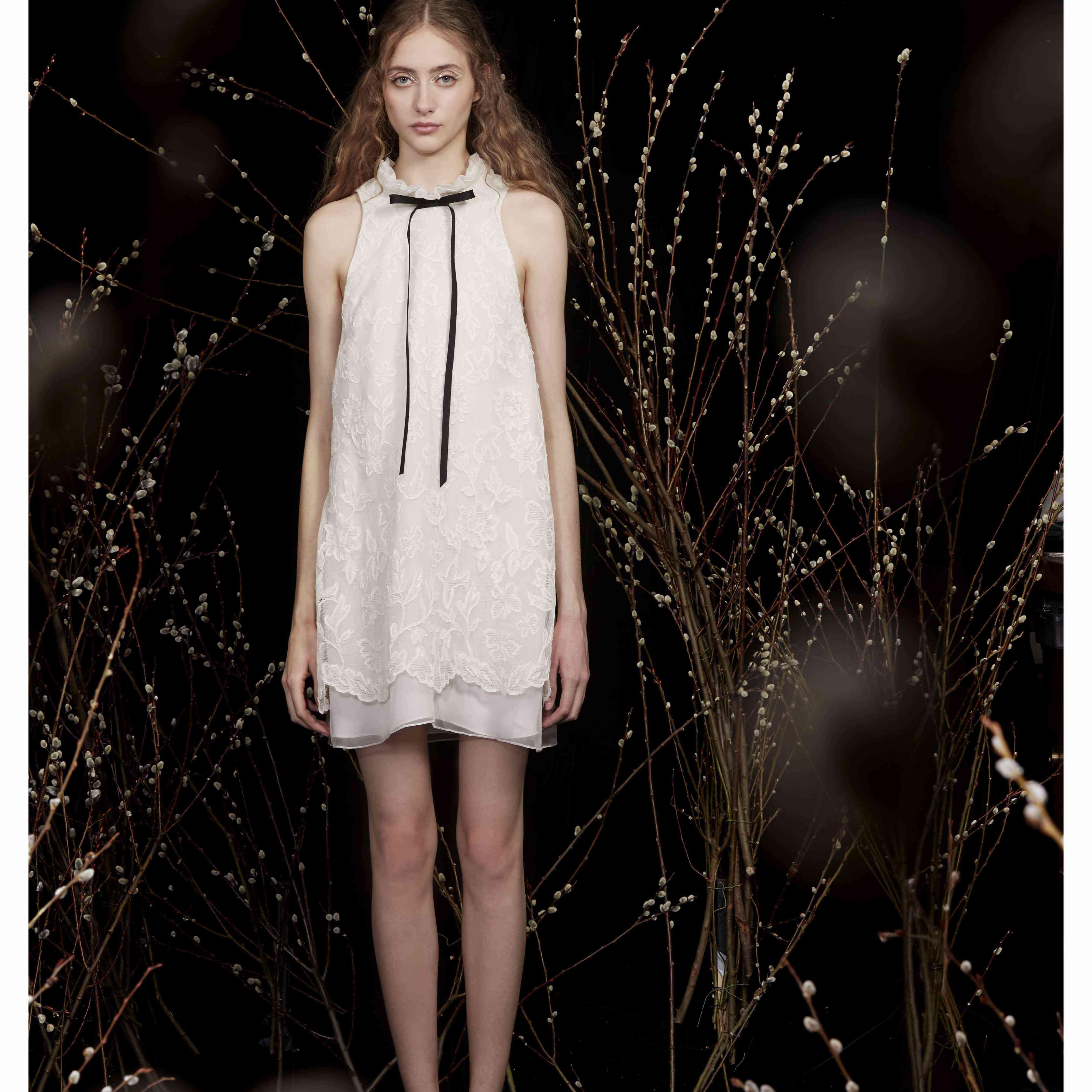 Model in ruffle collar mini wedding dress