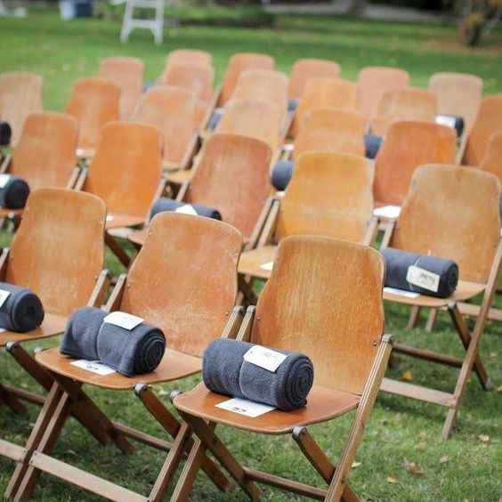 <p>Rolled Blankets on Wedding Ceremony Chairs</p>