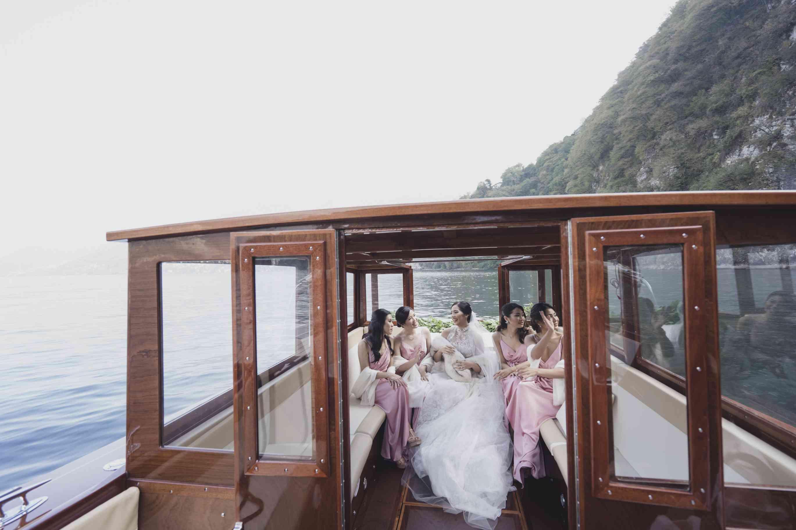 bride in boat with bridesmaids