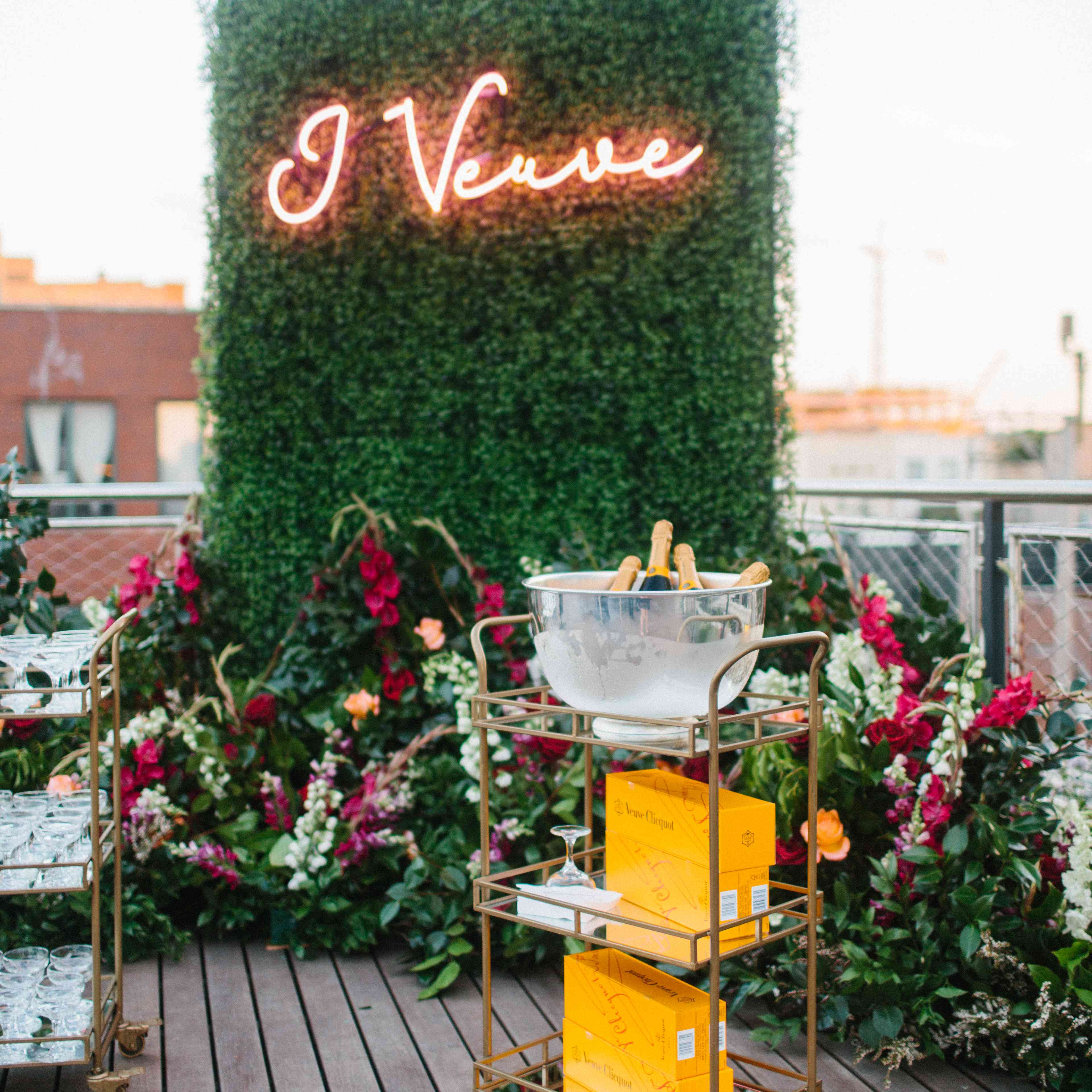 Neon sign backdrop to champagne bar cart